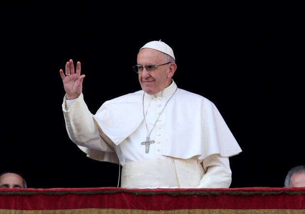 """Pope Francis waves as he arrives to leads """"Urbi et Orbi"""" (to the city and the world) message from the balcony overlooking St. Peter's Square at the Vatican"""